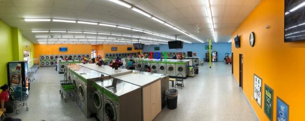 Atlas laundry Dallas laundromat equipment and happy customer