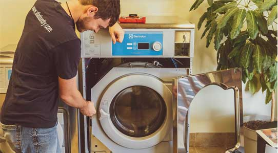 atlas laundry helps build laundromat